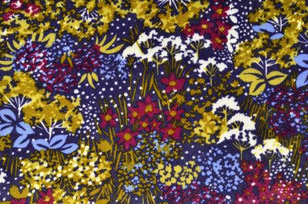 flores moradas: Autumn floral pattern on fabric. Blue, green, burgundy flowers print as background. Foto de archivo
