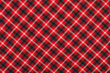 Scottish tartan pattern. Red, white and black plaid print as background. Symmetric rhombus square pattern.