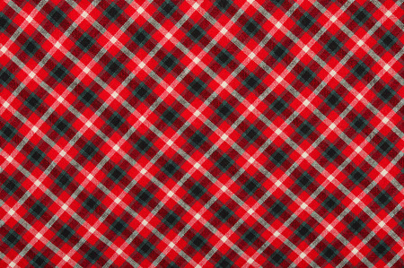 Scottish tartan pattern. Red, white and black plaid print as background. Symmetric rhombus square pattern.