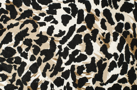 leopard fur: Brown and black leopard fur pattern. Spotted animal print as background. Stock Photo