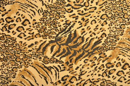 spotted fur: Brown and black leopard and tiger fur pattern. Spotted and striped animal print as background.