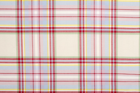 blue plaid: Scottish tartan pattern. Pink with white and blue plaid print as background. Symmetric square pattern. Stock Photo