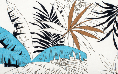linen texture: Tropical leaves pattern on white fabric. Black with blue and brown palm leaves print as background.