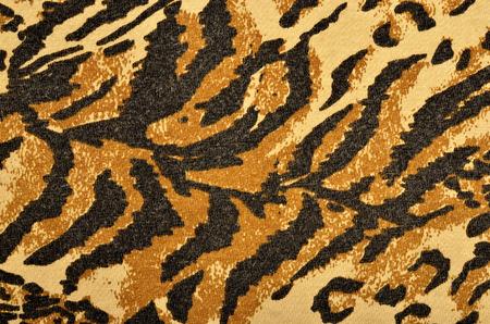 black tiger: Brown and black tiger fur pattern. Striped animal print as background.