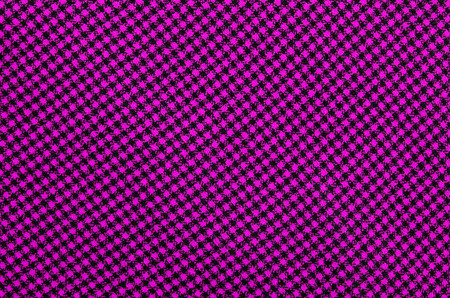 gingham: Closeup on pink checkered tablecloth wool fabric. Magenta with black gingham square pattern as background.