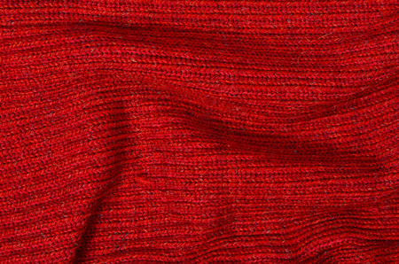 close knit: Wool sweater pattern as a background. Close up on red knit sweater texture fabric.