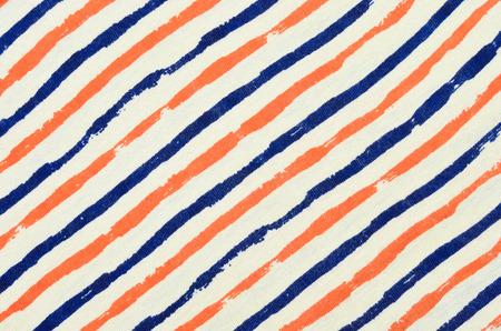 diagonal stripes: Blue and orange striped background. Diagonal stripes pattern on fabric.