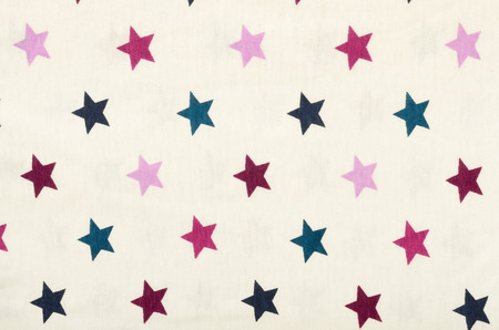 estrellas cinco puntas: Pink five-pointed stars on white fabric. Purple, pink and blue stars as a background. Foto de archivo