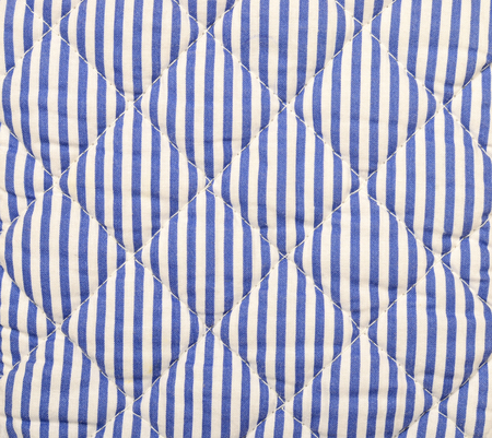 navy blue background: Navy blue striped background. Blue and white stripes quilted pattern on fabric.