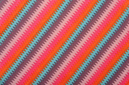 zig: Colorful zig zag striped background. Diagonal stripes pattern on fabric.