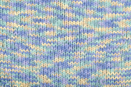 degrade: Wool sweater pattern as a background. Close up on blue and white degrade knit sweater texture fabric. Stock Photo