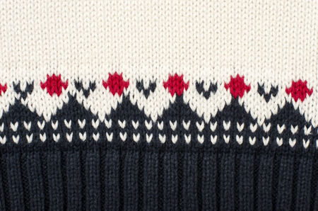 close knit: Wool sweater pattern as a background. Close up on winter motif knit woolen texture.