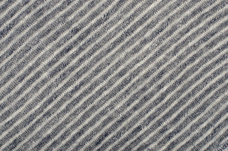 rayures diagonales: Blue striped background.Blue and white diagonal stripes pattern on fabric. Banque d'images