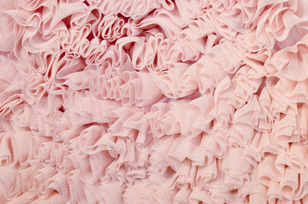 tulle: Close up on pink lace. Pastel pink crumpled tulle as background. Stock Photo