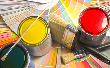 color palette: Paint samples. Sample of colorful paint. Cans of red, yellow and green paint. Stock Photo