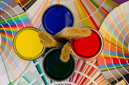 paint samples: Paint samples and cans. Sample of colorful paint. Cans of red, yellow, blue and green paint.