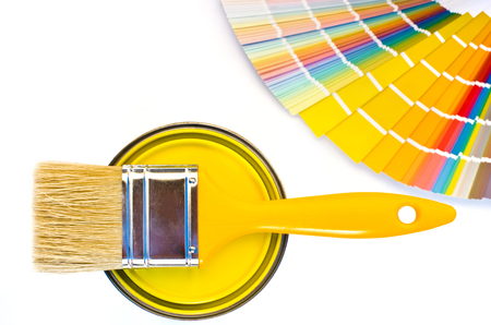 yellow paint: Yellow paint and swatch. Samples with different shades of yellow and can of yellow paint with a brush. Stock Photo