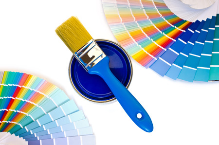 painter palette: Blue paint and swatches. Samples with different shades of blue and can of blue paint with a brush. Focus on the can. Isolated on white background. Stock Photo