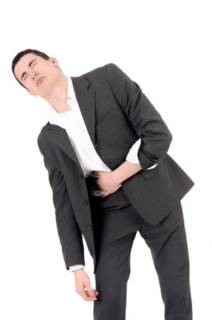 man stomach ache: Sad business man having pain, stomach ache. Isolated on white background.