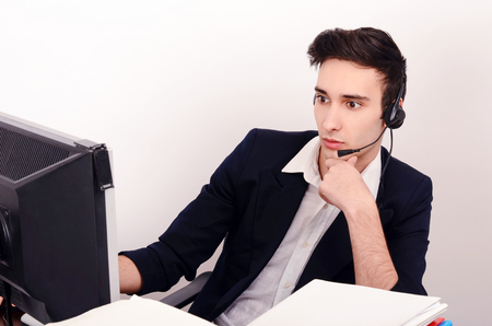 man think: Young man customer support phone operator with headset. Call center operator at work in the office.