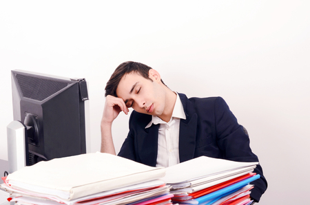 unsatisfied: Tired business man sleeping at work. Exhausted worker sleeping at the desk. Stock Photo