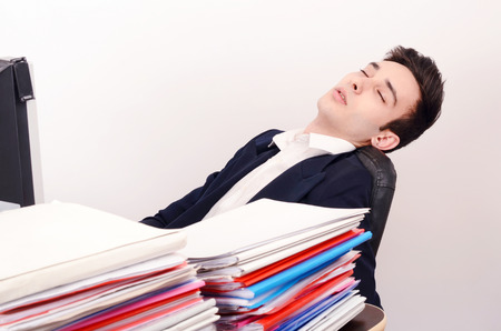 exhausted worker: Tired business man sleeping at work. Exhausted worker sleeping at the desk. Stock Photo