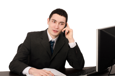 call out: Business man sitting at desk talking on the phone. Happy business man hearing good news on the phone. Isolated on white. Stock Photo