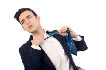 tearing: Young business man undressing his suit, pulling his tie. Business is over, the stress is too much concept.