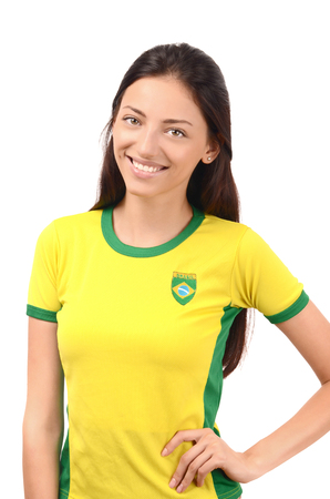 white flag: Beautiful Brazilian girl. Attractive girl with Brazilian flag on her yellow t-shirt. Isolated on white. Stock Photo