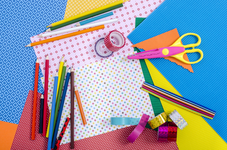 craft supplies: Arts and craft supplies. Color paper, pencils, different washi tapes, craft scissors.