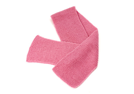nicely: Cute pink winter scarf nicely arranged. Wool scarf isolated on white background.