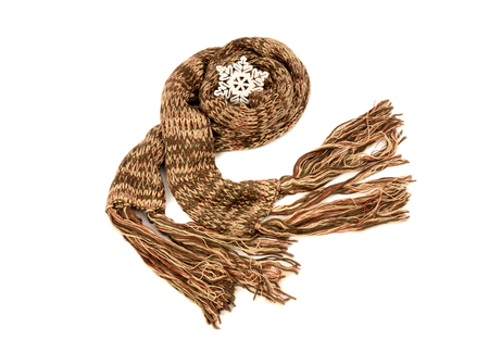fringe: Long brown winter scarf with fringe. Brown scarf decorated with snowflake isolated on white background.