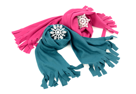 nicely: Pink and blue wool scarves nicely arranged. Winter accessories isolated on white background.