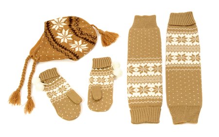 leg warmers: Brown winter accessories isolated on white background. Wool mittens, hat and leg warmers nicely arranged.