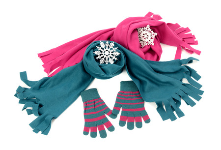 nicely: Styling a scarf with matching gloves. Pink and blue wool scarves nicely arranged. Winter accessories isolated on white background. Stock Photo