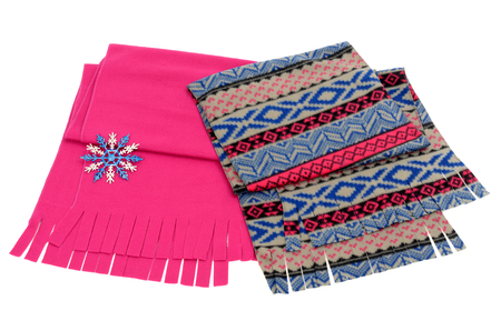 matching: Nicely folded winter scarf with fringe. Matching pink and blue scarves isolated on white background. Stock Photo