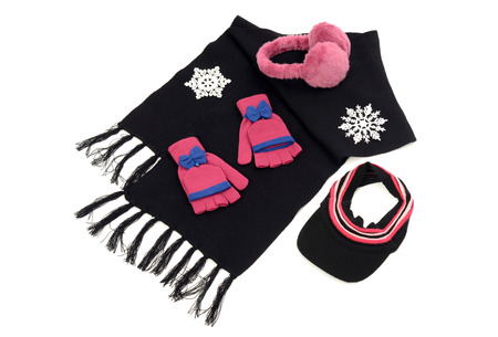 mohair: Pink and black winter accessories isolated on white background. Black wool scarf with matching pink gloves,a visor hat and earmuffs.