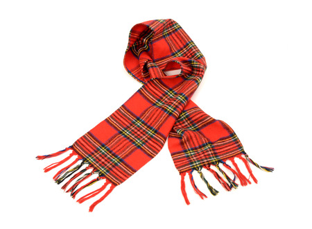 Tartan winter scarf with fringe. Red plaid scarf isolated on white background. Stock Photo