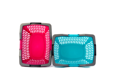 nicely: Blue and pink plastic shopping basket isolated on white. Colorful plastic market baskets nicely arranged.