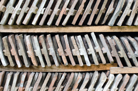 wood shelf: Rows of arranged bricks on a wood shelf. Abstract background. Stock Photo