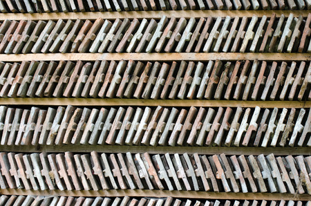 arranged: Rows of arranged bricks on a wood shelf. Abstract background. Stock Photo