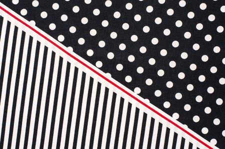 Polka dots and stripes pattern. Half white dots and half vertical stripes print on dark blue as background. Stockfoto