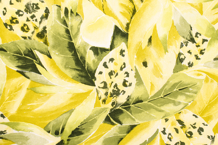Green leopard pattern and yellow leaves on material. Leaf shape with spotted animal print as background. Stockfoto
