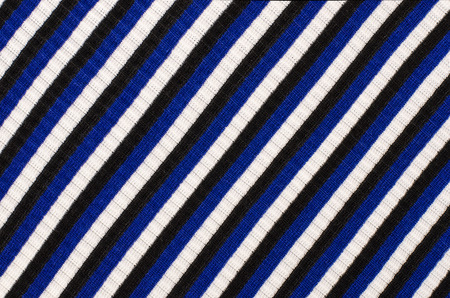 navy blue background: Navy blue striped background. Blue with black and white diagonal stripes pattern on fabric.
