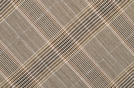checked fabric: Brown guncheck pattern. Tartan design as background. Checked fabric.