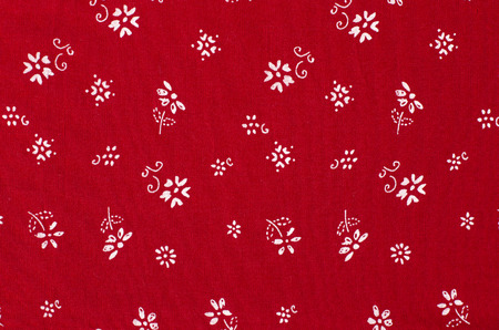 Small Floral Pattern On Red Fabric White Flowers Print As Background Photo