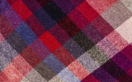 linen fabric: Scottish tartan pattern. Red plaid print as background. Colored lines and square pattern. Scottish checked fabric. Stock Photo