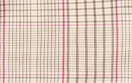 checked fabric: Brown and pink guncheck pattern. Tartan design as background. Checked fabric.