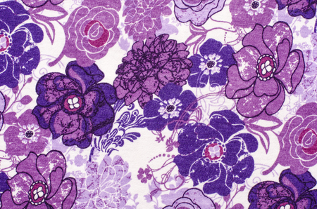 mauve: Purple floral pattern on white fabric. Mauve abstract flowers print as background. Stock Photo