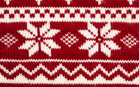 close knit: Close up on knit woolen texture. Winter snowflakes shapes pattern background.